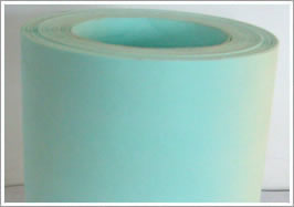 A roll of green air filter paper