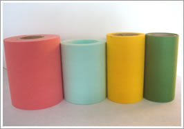 Four filter paper rolls in red, green, yellow and blue color
